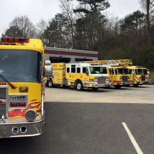 Four Yellow Alabaster Fire Department Trucks